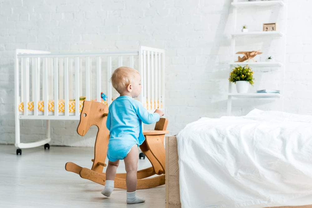 when to move from cot to bed